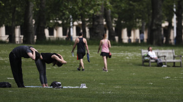 Time for a bit of exercise: People in St James Park in London.