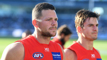 Gold Coast's Steven May (left) has met with Melbourne and is considering his future.
