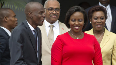 First lady Martine Moise, pictured in red, was also shot in the attack but survived.