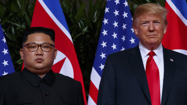 President Donald Trump stands with North Korean leader Kim Jong-un during a meeting on Sentosa Island, in Singapore, in June last year. That meeting is deemed to have achieved little of substance.