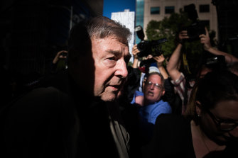 """Age photographer Jason South won  Photo of the Year Prize at the 2019 Nikon-Walkley Awards for """"Running the gauntlet"""", which featured George Pell outside court."""