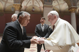 Pope Francis exchanges gifts with Hungarian Prime Minister Viktor Orban, at Budapest's Museum of Fine Arts.