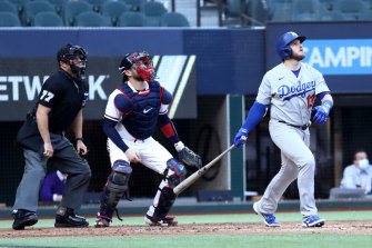 Max Muncy watches the ball leave the yard as his grand slam capped an 11-run first inning for the Dodgers.