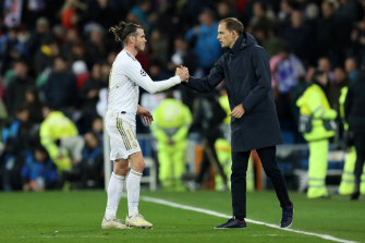 Gareth Bale and PSG manager Thomas Tuchel shake hands after Real Madrid and PSG's 1-1 draw.