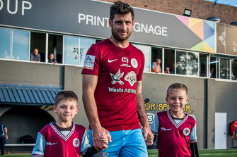 APIA Leichhardt striker Chris Payne with sons Cohen (left) and Cayde (right).