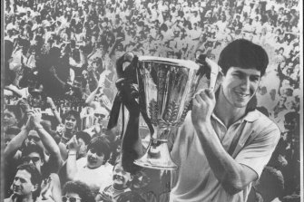 Stephen Kernahan holds up the 1987 premiership cup.