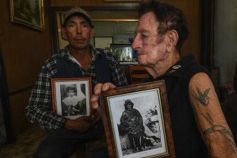 Rodney Dowling (left) with his father Fred and portraits of Fred's grandmother Annie Lewis and Mary Jane Milewa.