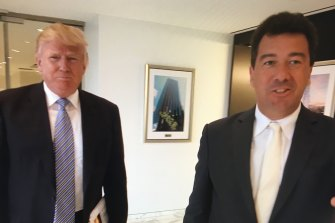 "Trump with this article's author Nick Bryant in 2014. Bryant says his choice of attire that day, ""a white silk tie that would not have looked out of place at a mob wedding in Queens or New Jersey, showed how ingratiatingly we entered his orbit""."
