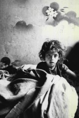 """""""Sara, a child of the Warsaw ghetto. Her father painted the flowers on the wall for her."""" From Roman Vishniac's collection of photos <i>A Vanished World</i>."""