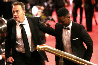 Hawthorn coach Alastair Clarkson with Nelly Yoa on the Brownlow red carpet in 2018.