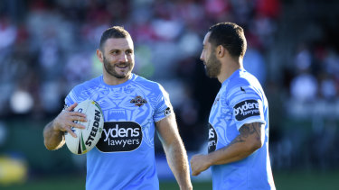 Old guard: Tigers veterans Robbie Farah (left) and Benji Marshall are part of the leadership group.