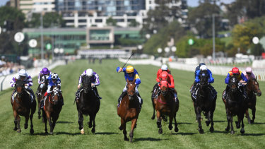 Santa Ana Lane (centre) leads the field home at Flemington.