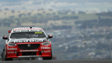 Jamie Whincup comes into view at Mount Panorama.