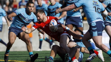 Championship hour: Blake Wallace scores for Wolfpack as Featherstone Rovers' Makahesi Makatoa tries to pull him down.