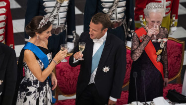 Denmark's Crown Princess Mary, from Australia, toasts French President Emmanuel Macron, centre, next to Queen Margrethe, right, at Christiansborg Palace for a State Banquet last year.