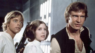 Mark Hamill, from left, as Luke Skywalker, Carrie Fisher as Princess Leia Organa, and Harrison Ford as Hans Solo in the original 1977 <Star Wars: Episode IV - A New Hope.?