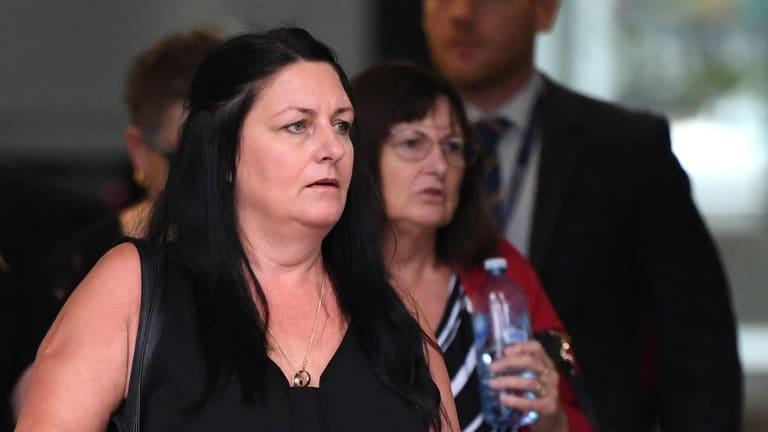 Jennifer Merrigan, the wife of Shane Merrigan, leaves the Supreme Court after Tamate Heke was sentenced.