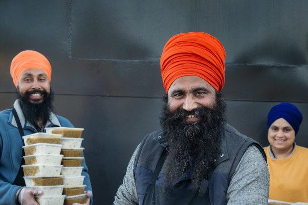 Sikh volunteers Manpreet Singh, Gurkirapal Singh and Sukhwinder Kaur.