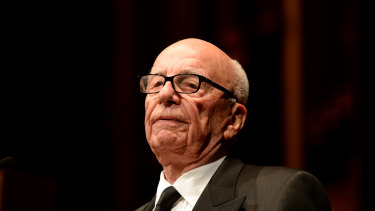 Rupert Murdoch is giving up his bonus after News Corporation reported a quarterly loss.