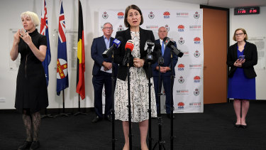 Premier Gladys Berejiklian with Health Minister Brad Hazzard, Police Minister David Elliott and Chief Health Officer Dr Kerry Chant.