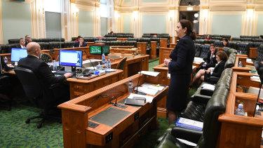 Queensland Premier Annastacia Palaszczuk addresses an almost-empty chamber.