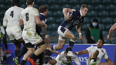 Scotland's Duhan van der Merwe charges to the line to score a try during the Six Nations rugby union international between England and Scotland at Twickenham stadium in London, Saturday, Feb. 6, 2021.