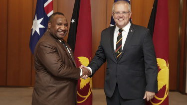 Prime Minister Scott Morrison was due to meet PNG PM James Marape, left, next week.