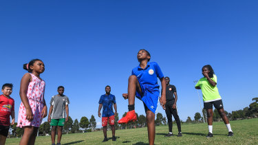 Eangano Singehebhuye teaches  children whose parents can't afford sporting club fees how to play soccer for free.