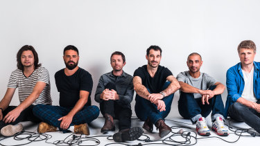 Felix Riebl (third from right) and his Cat Empire bandmates have weathered changing times and musical fashions.