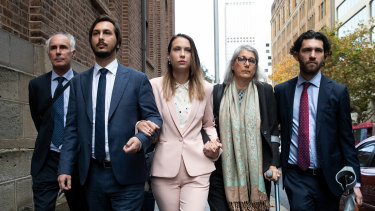 Hannah Quinn (centre) arrives at the NSW Supreme Court on Friday to be sentenced.