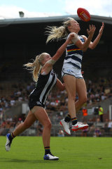 Geelong's Phoebe McWilliams, right, takes a mark ahead of Lauren Butler.