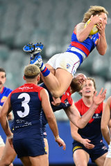 Cody Weightman soars over Max Gawn.