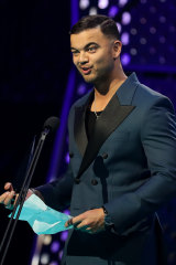 Guy Sebastian accepts his surprise song-of the year award.
