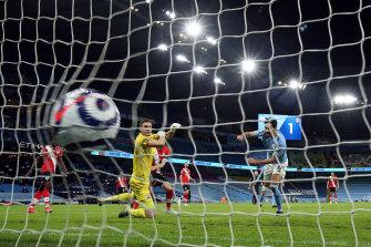 Ilkay Gundogan scores Manchester City's third goal.