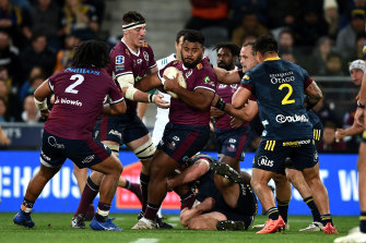 Taniela Tupou of the Reds attempts to break through the defence during the round one Super Rugby Trans-Tasman match in Dunedin.