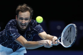 Daniil Medvedev stretches for a return during his come-from-behind ATP Finals victory over Dominic Thiem.