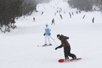 The slopes are busy on the opening day of the ski season at Thredbo.