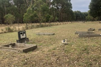 The headstone of Monty and Lyall Foster stands among unmarked graves at the Lake Condah Mission Cemetery.