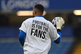 Robert Sanchez, of Brighton & Hove Albion, warms up wearing a T-shirt with a message before the team's Premier League match against Chelsea on Tuesday.