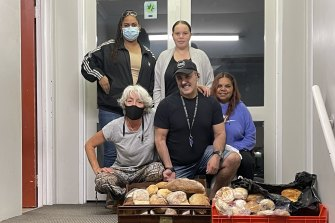 Perth City Apartment Hotel Eddie Kamil, centre, with bread used to feed his guests.