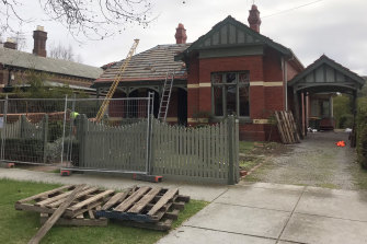 Demolition crews started work on the house on Thursday.