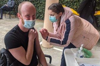 Liam receiving his first dose of AstraZeneca.