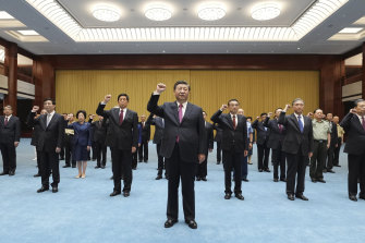 President Xi Jinping, centre, reviews with Communist Party admission oath on a visit to the Museum of the Communist Party of China.