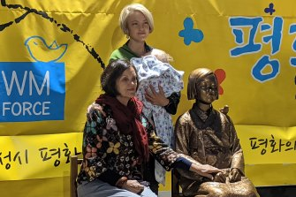 Ruby (standing) and Carol Challenger, granddaughter and daughter of Jan Ruff O'Herne, with the statue in Oakleigh. O'Herne was a Dutch-Australian woman forced into sex slavery by the Japanese military during World War II. Ruby Challenger has received funding from Korean groups to make a film about her grandmother's experiences.