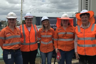 Professor Else Shepherd AM (right) poses with female engineers working on Brisbane's Cross River Rail project: (from left) Alena Conrads, Kylee Bishop, Megan Wood and Bridget Goldsworthy.