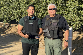 Mark Fennell with an investigator while recording for Nut Jobs.