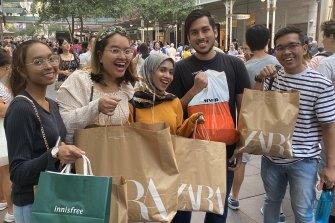 Randwick residents Nurul Aida, Hanis Fatehah, Dang Anum, Hazrain Arsyad and Faiz Mahmud at the Boxing Day sales.
