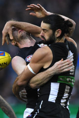 The navy blue on Sam Rowe mixes with Brodie Grundy's black at the MCG on Sunday.