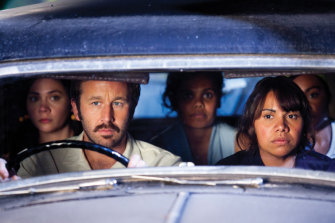 Dave Lovelace (Chris O'Dowd, left) and Gail (Deborah Mailman) in a scene from The Sapphires.