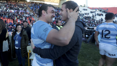 All smiles: Argentina's Agustin Creevy (left) embraces assistant coach Gonzalo Quesada after beating South Africa.